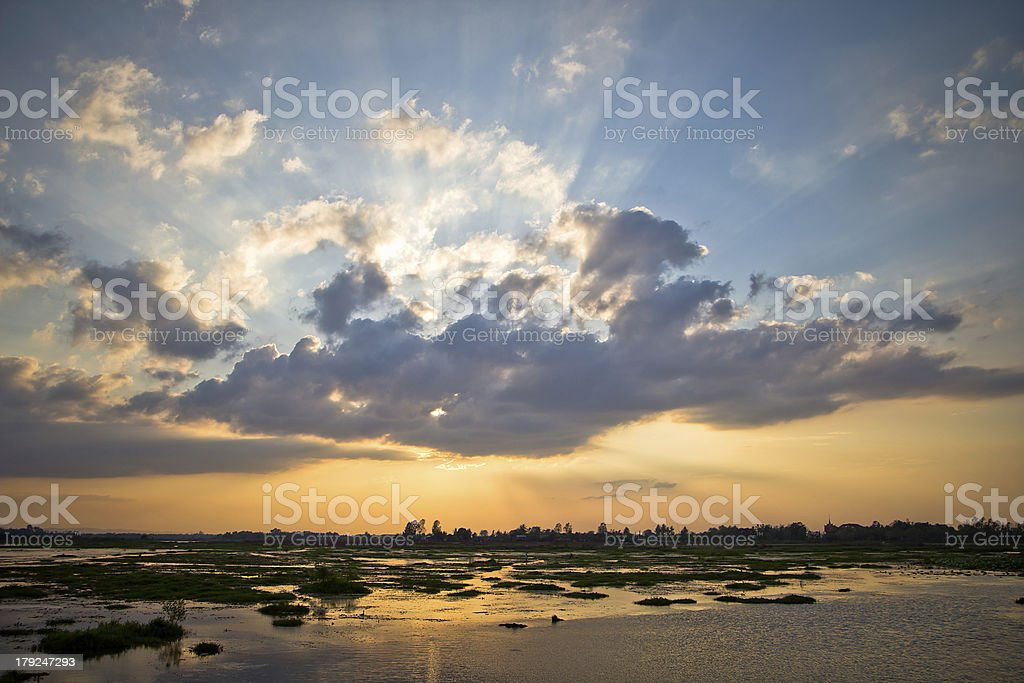 sunset with sun ray on fresh water royalty-free stock photo