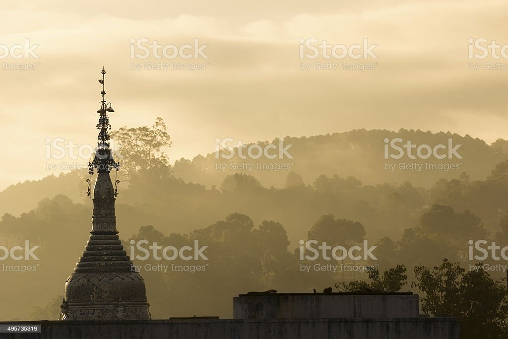 Sunset with temple in Kalaw (Myanmar) stock photo