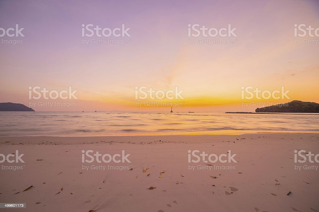 Sunset with the beach and tropical sea stock photo