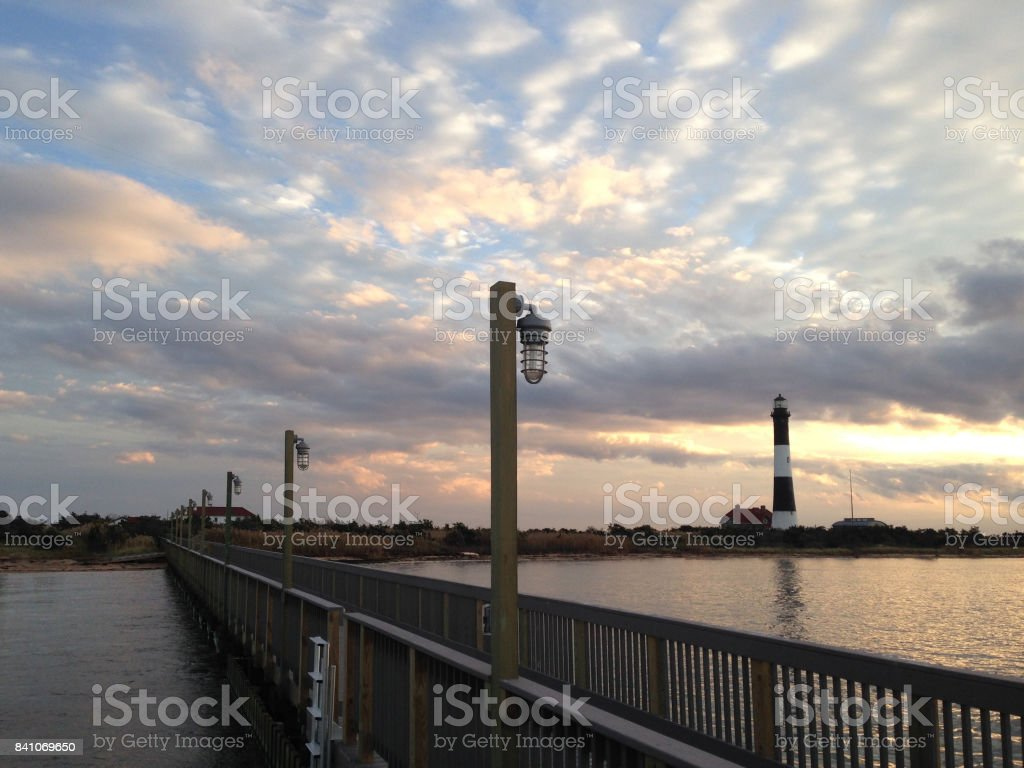 Sunset with the Fire Island Lighthouse in the Distance. stock photo