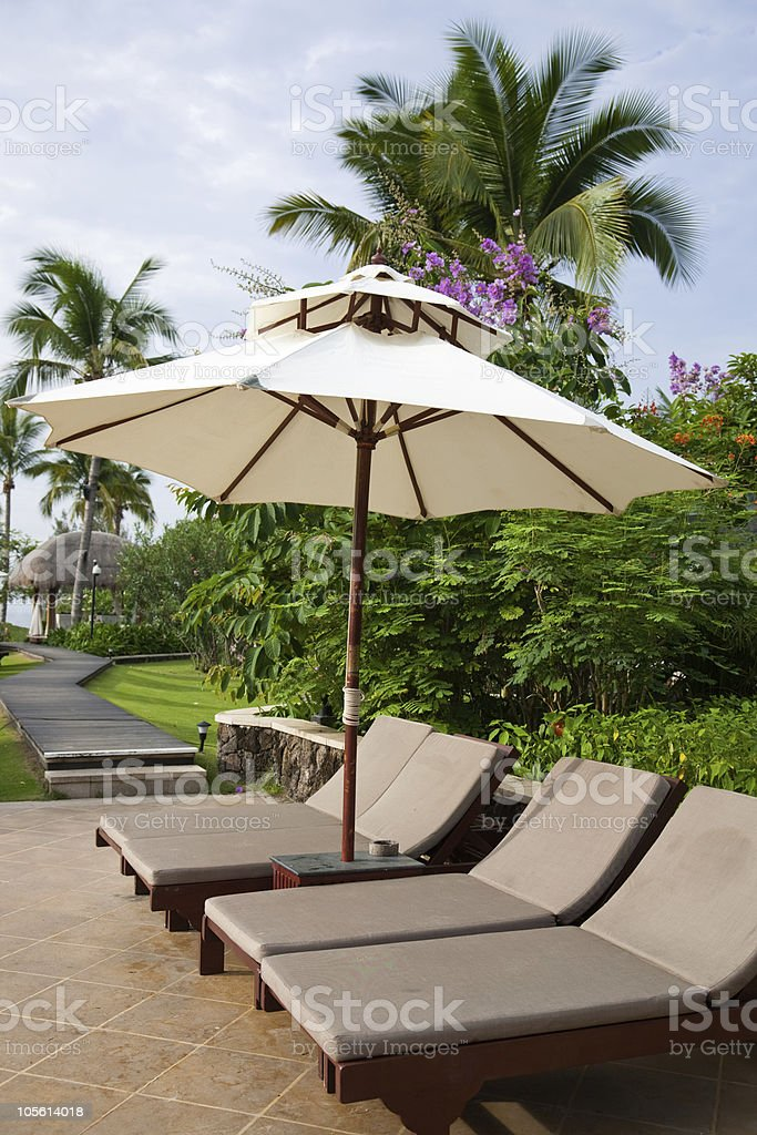 sunshade and chaise longue royalty-free stock photo