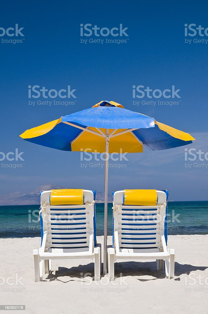 sunshade and two chairs at beach royalty-free stock photo