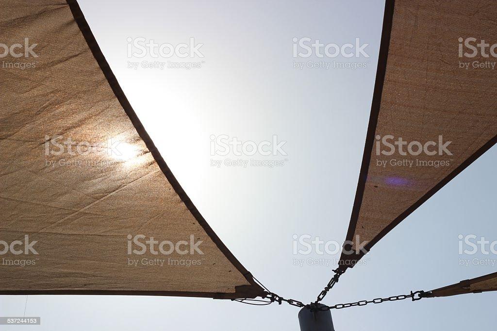 Sunshade sun and blue sky stock photo