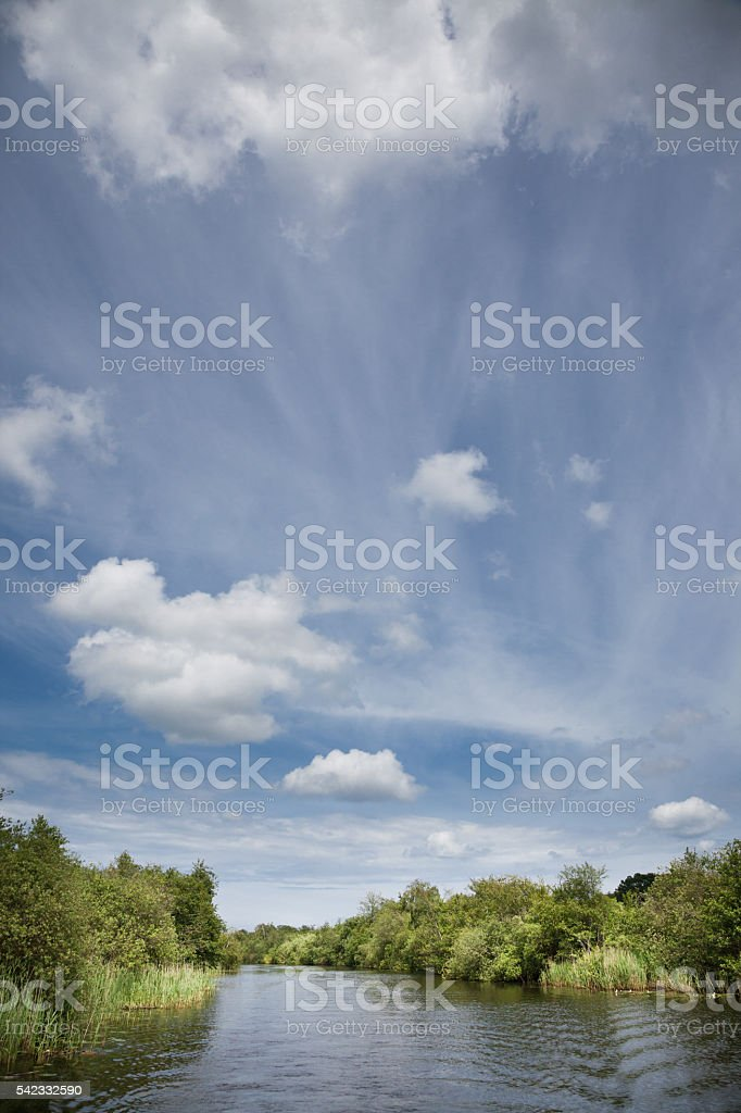 sunshine and cloudscape on River Ant on Norfolk Broads England stock photo