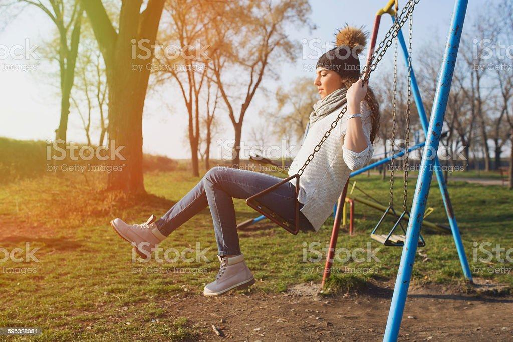 Sunshine and swinging stock photo