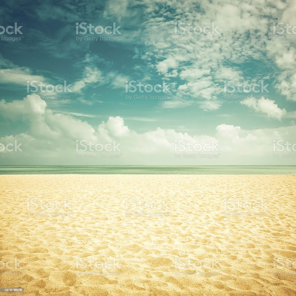 Sunshine on empty beach - vintage look stock photo