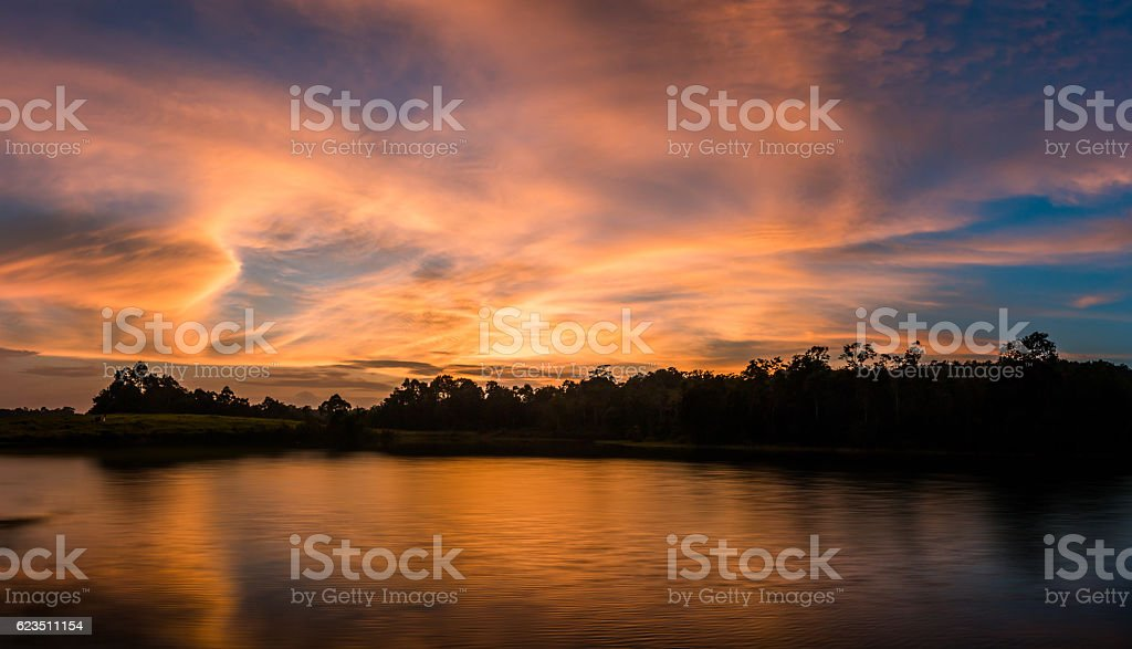 sunshine on sunset with Silhouette, sky and cloud stock photo