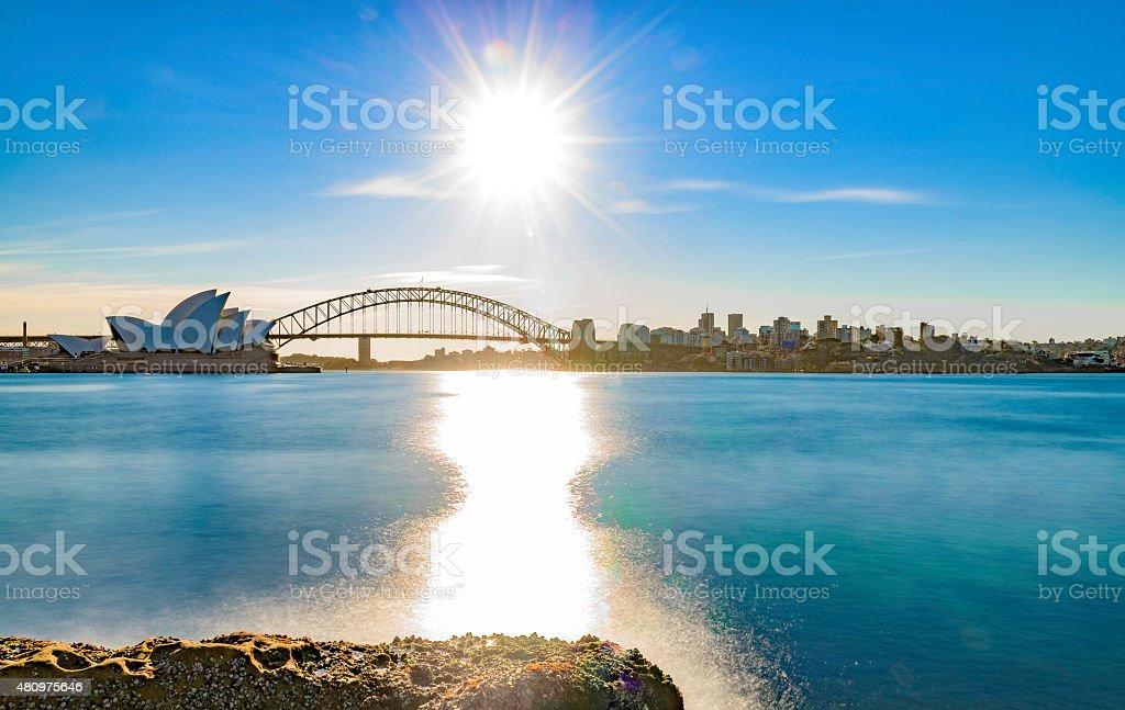 Sunshine over calm waters stock photo