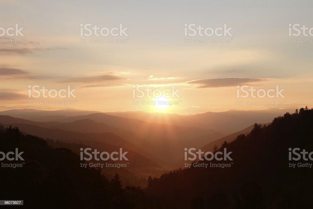 Sunshine over Mountain Peaks stock photo