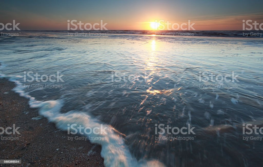 sunshine over North sea at sundown stock photo
