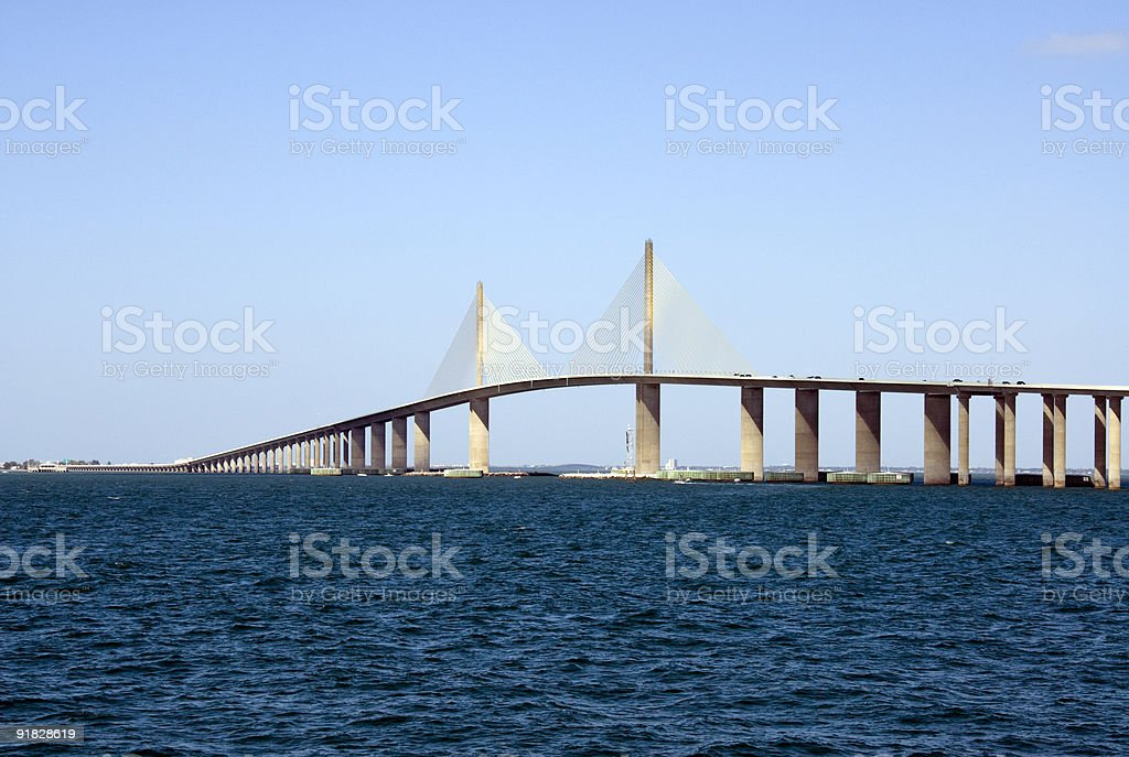 Sunshine over the Skyway Bridge across the deep blue sea stock photo