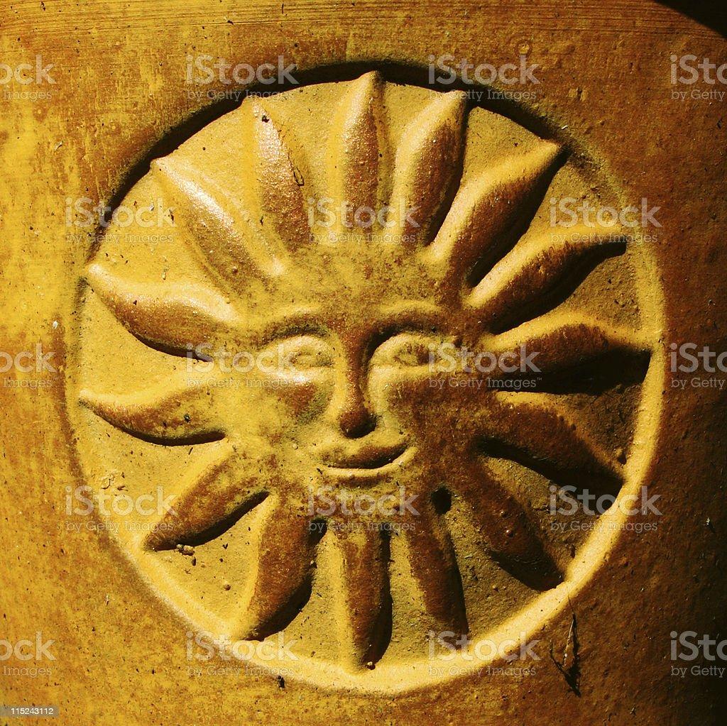 Sunshine symbol on terracotta plant pot royalty-free stock photo