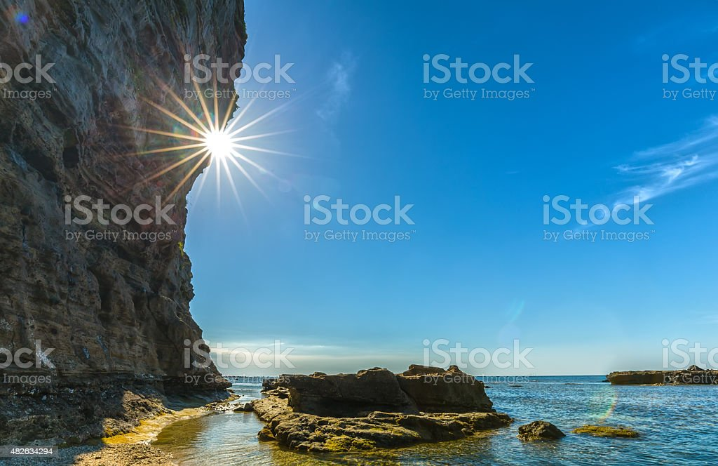 Sunstar afternoon cliff side fire stock photo