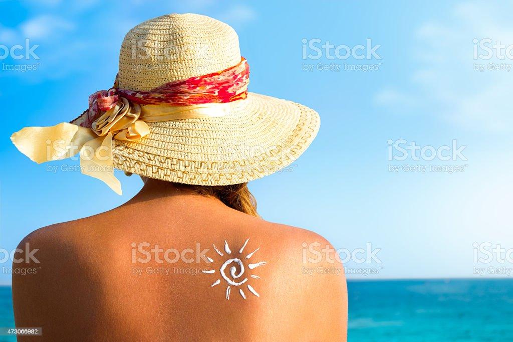 Suntan lotion woman with sunscreen solar cream stock photo