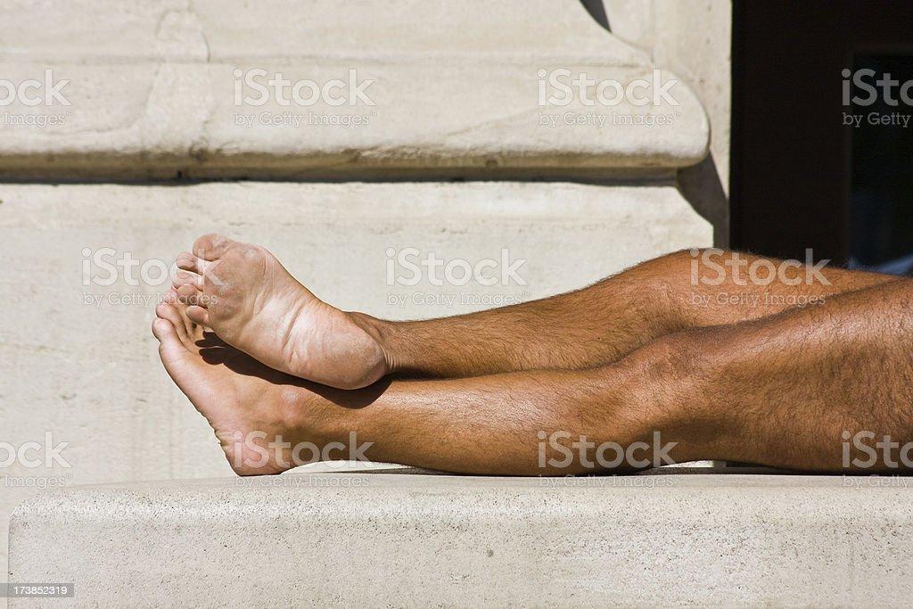 suntanned male legs royalty-free stock photo