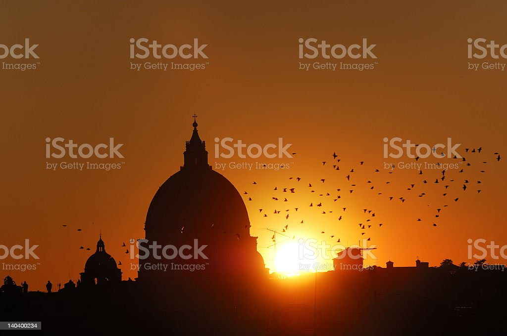 Suntet on St Peter's cupola in Rome royalty-free stock photo