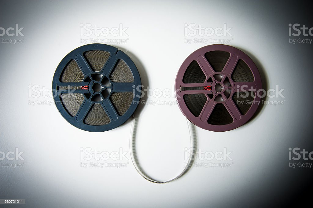 super 8mm movie reels connected with film in  color effect stock photo