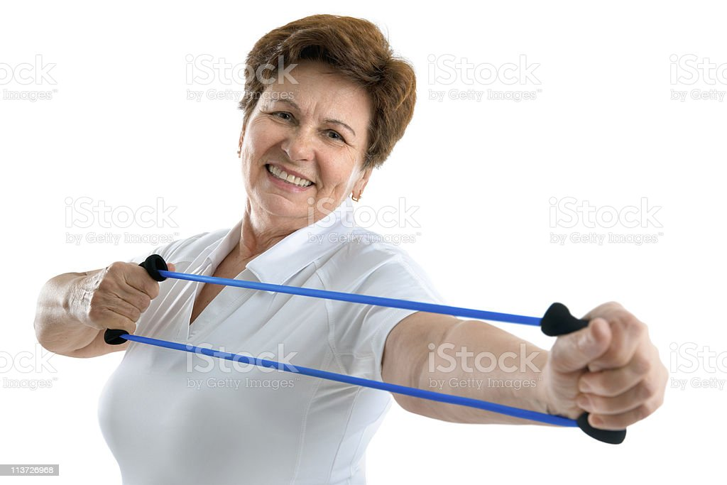 Super active senior woman working her arms  stock photo