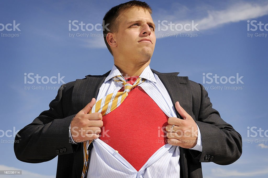 Super Businessman Ripping His Shirt Off  To Save The Day stock photo