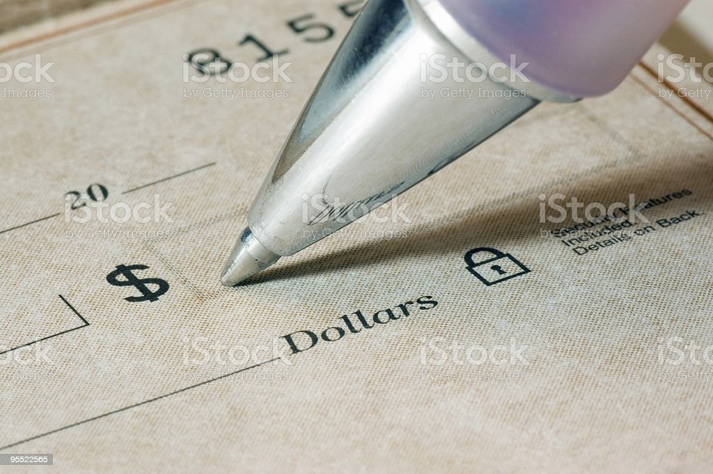 Super close-up photo of a ballpoint pen, and a bank check stock photo