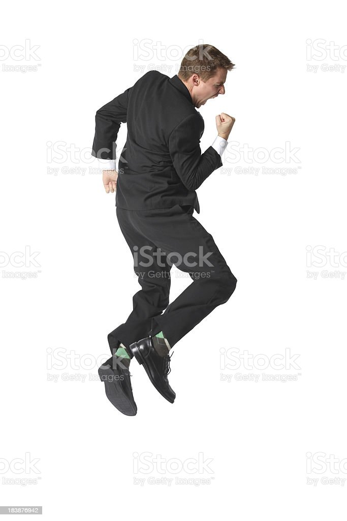 Super excited young businessman mid air fist pump royalty-free stock photo