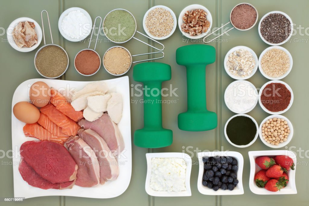 Super Food and Dumbbells for Body Builders stock photo