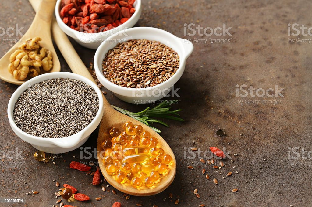 Super food - goji berries, chia seeds, flax seeds, walnuts stock photo