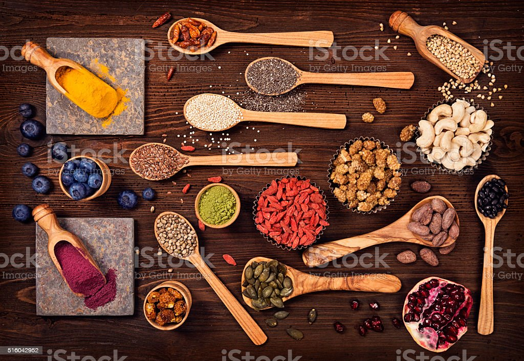 Super foods in spoons and bowls stock photo