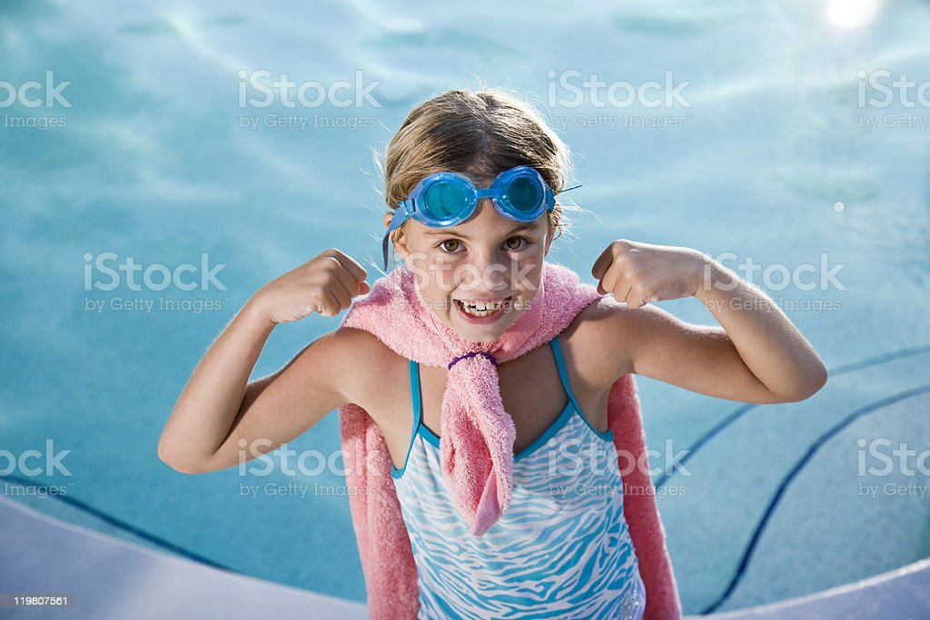 Super girl protecting the pool stock photo
