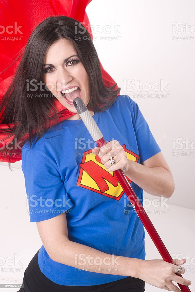 Super Mom Singing Karaoke Superhero with Broom Stick stock photo