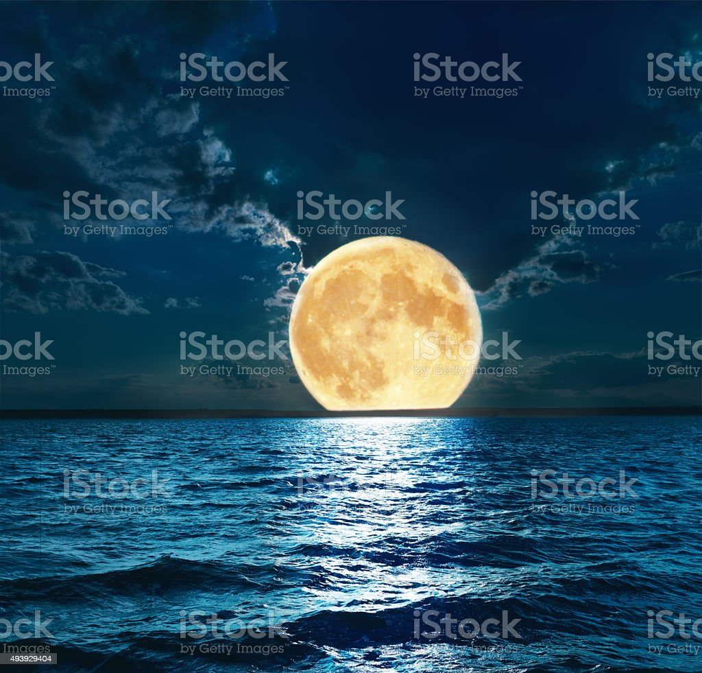 super moon over water stock photo