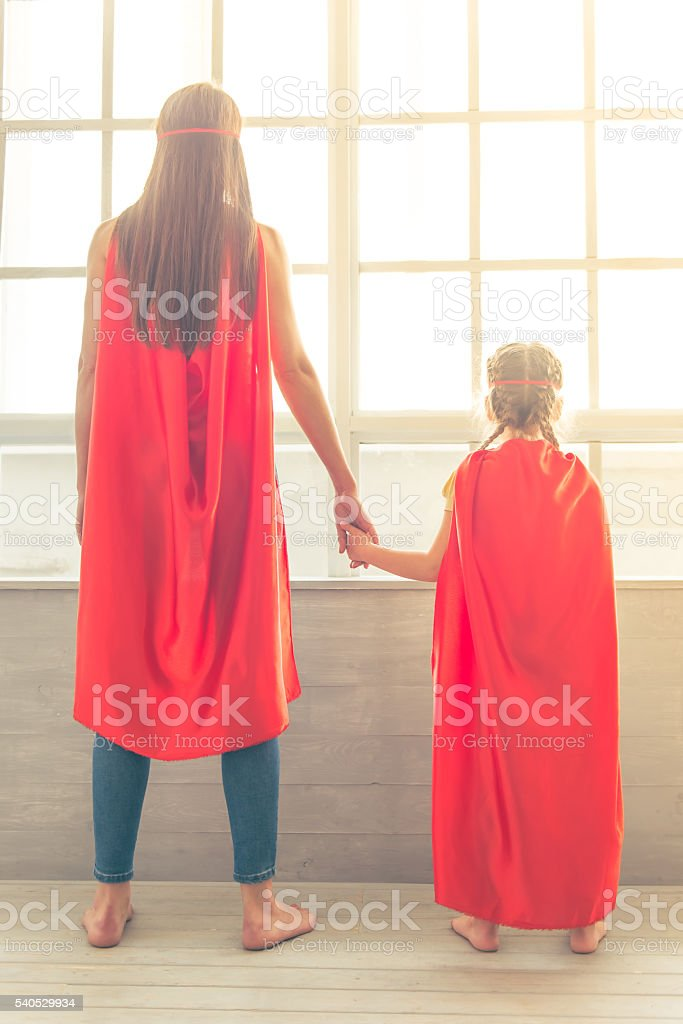 Super mother and daughter stock photo