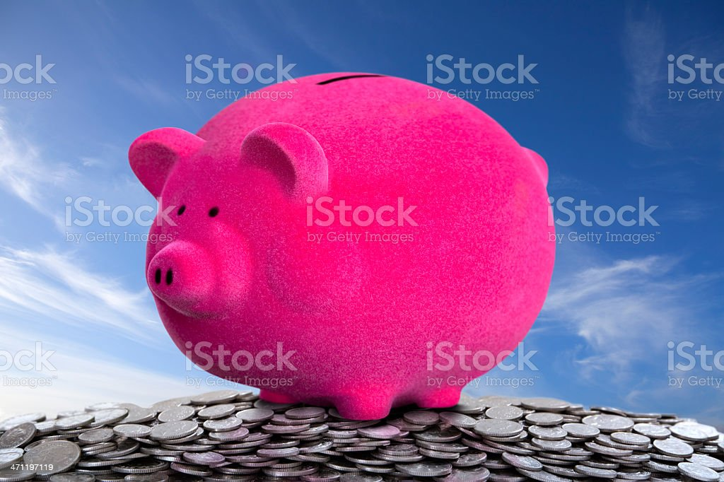 Super Savings Growth Piggy Bank on Money Mountain stock photo