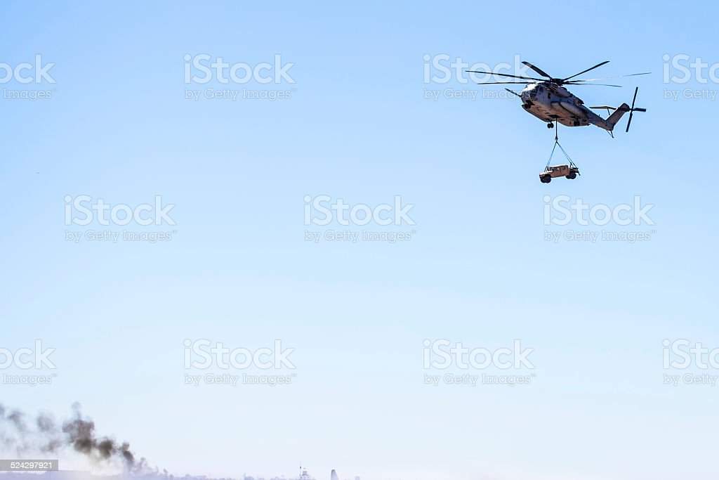 CH-53E Super Stallion (Sikorsky) Helicopter carrying military humvee stock photo