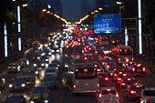 Super traffic jam: night scene of urban rush hours