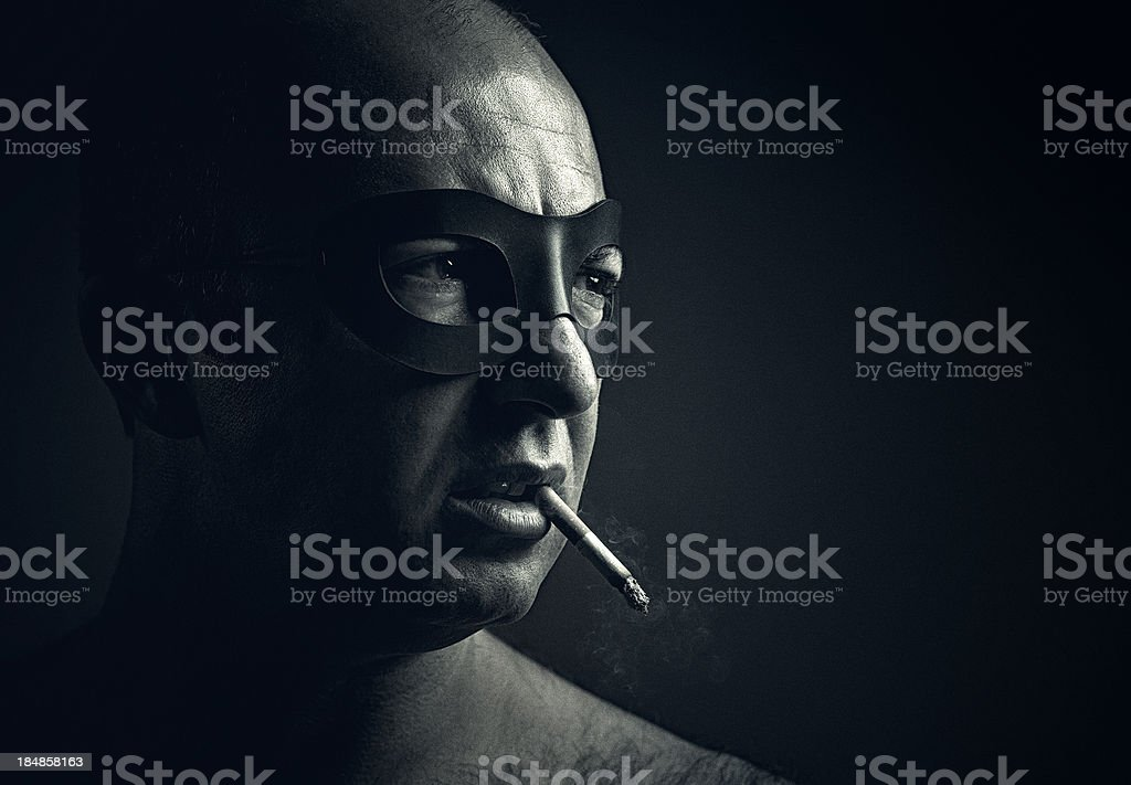 super villain smoking in the dark royalty-free stock photo