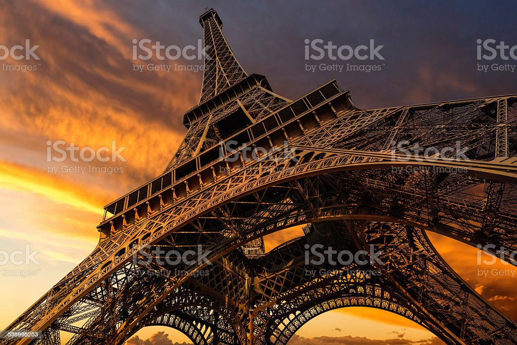 Super wide shot of Eiffel Tower under dramatic sunset stock photo