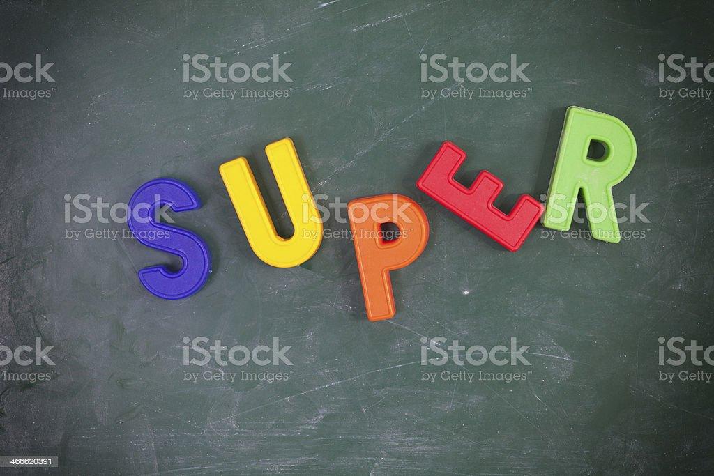 Super. Written on a blackboard. stock photo