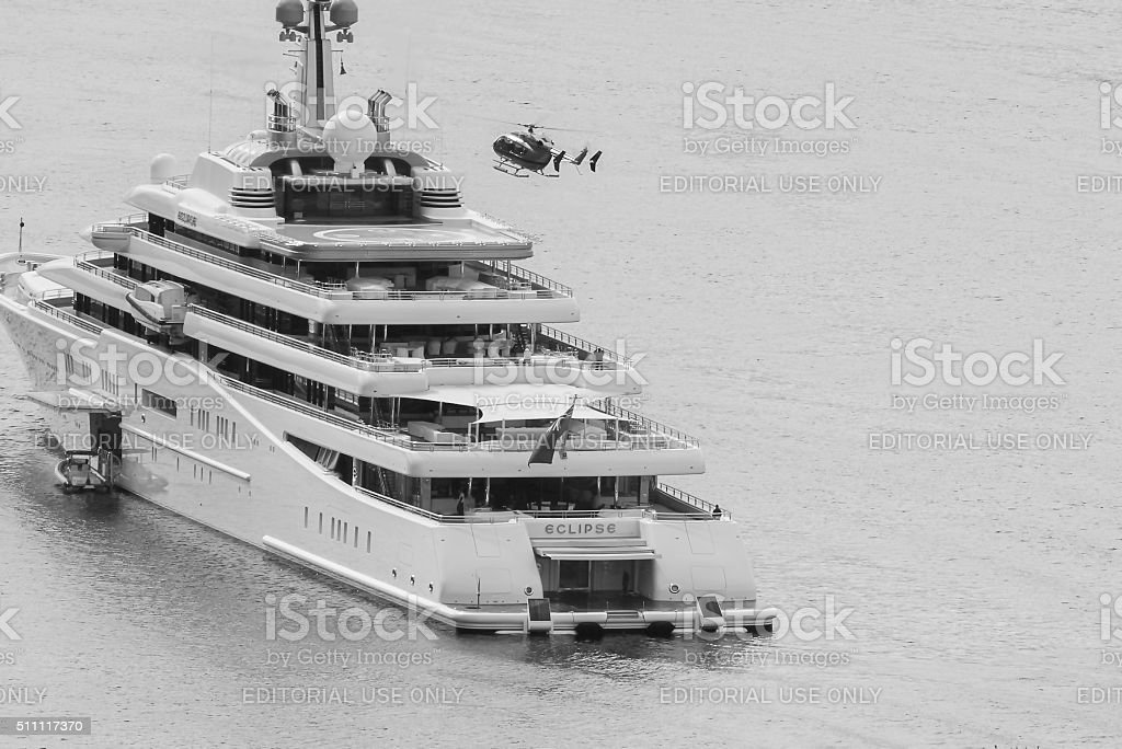Super yacht and helicopter stock photo