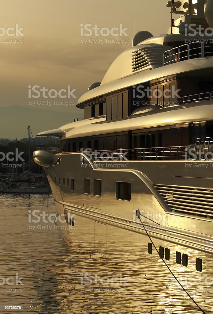 Super yacht in port at sunset stock photo