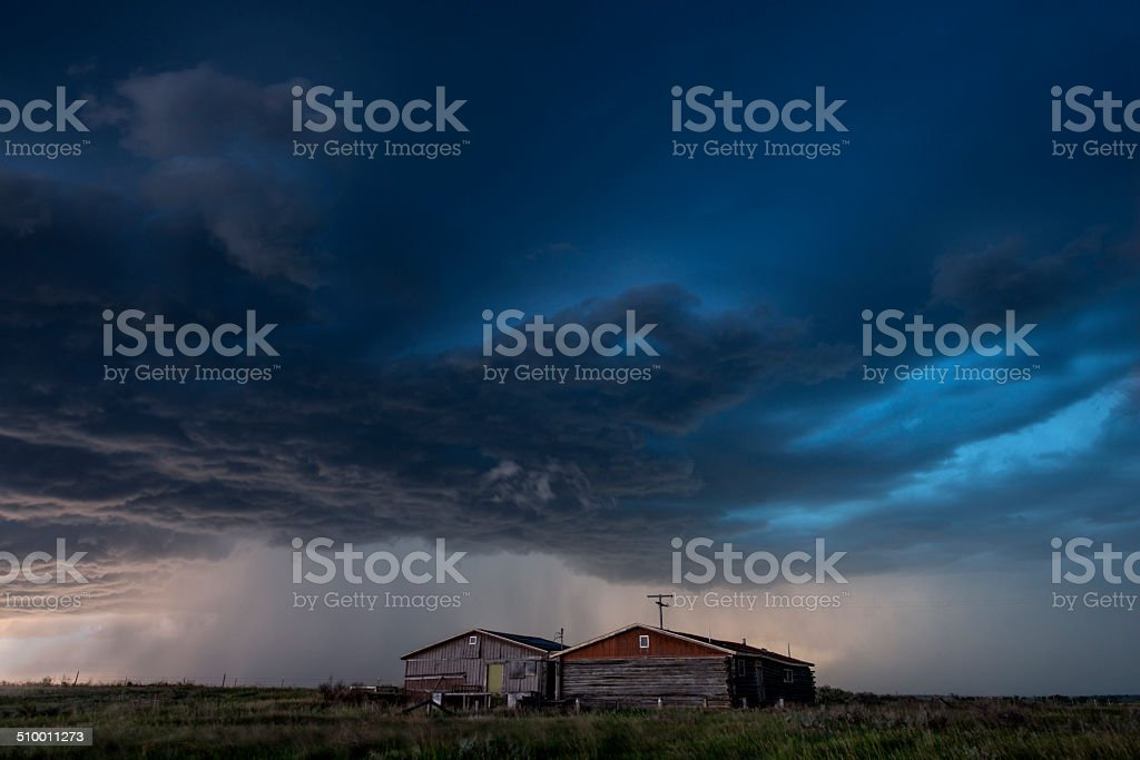 Supercell thunderstorm over buildings stock photo