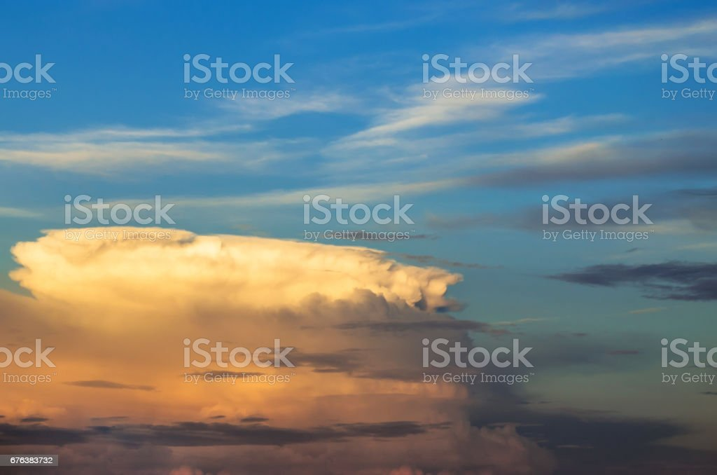 Supercell thunderstorm sunset and the blue sky and cirrus clouds. stock photo
