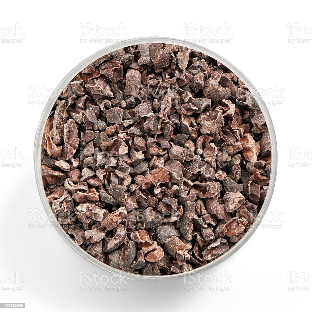 superfood cacao nibs shot from above in a glas jar stock photo