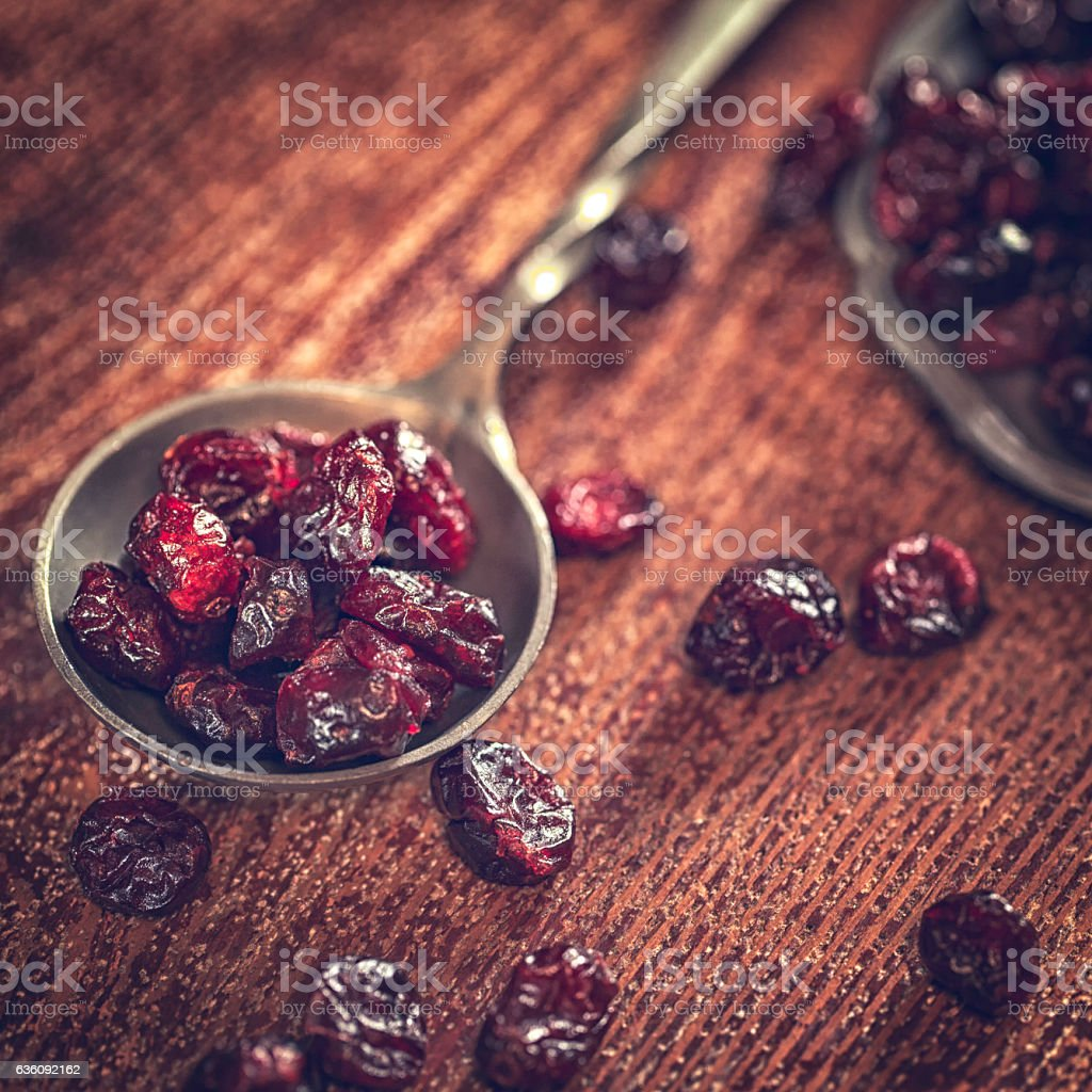 Superfood Dried Cranberries on Wooden Background stock photo
