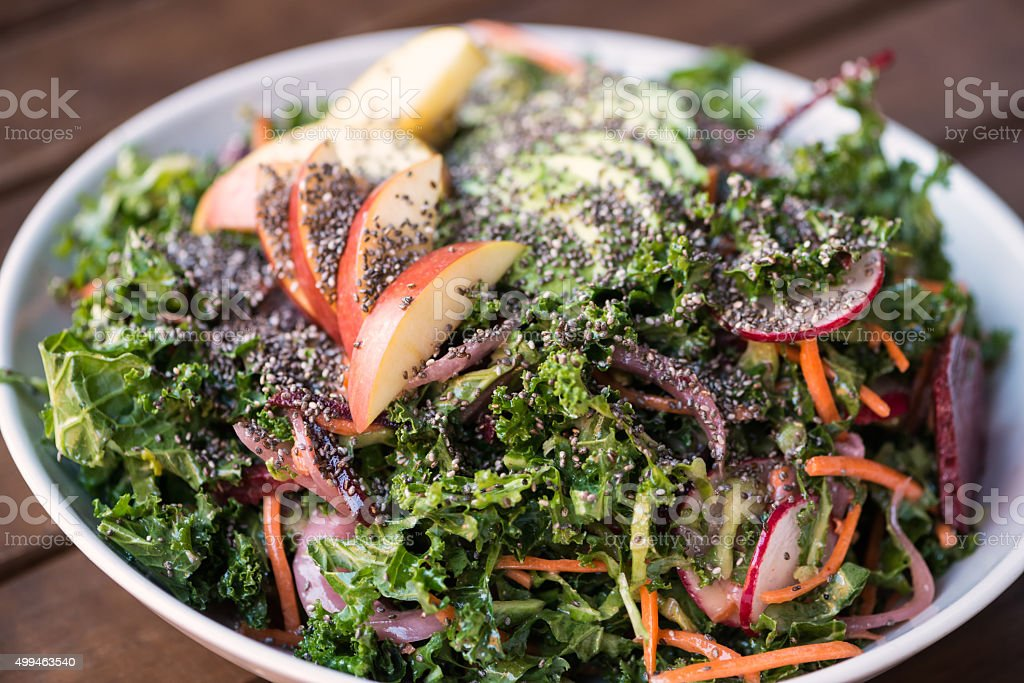 Superfood Salad with Kale, Apple, Chia Seeds, Avocado, Carrots, Radish stock photo
