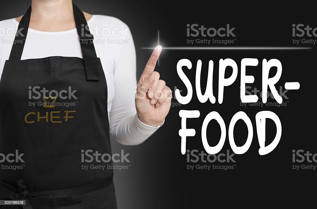 superfood touchscreen is operated by chef stock photo