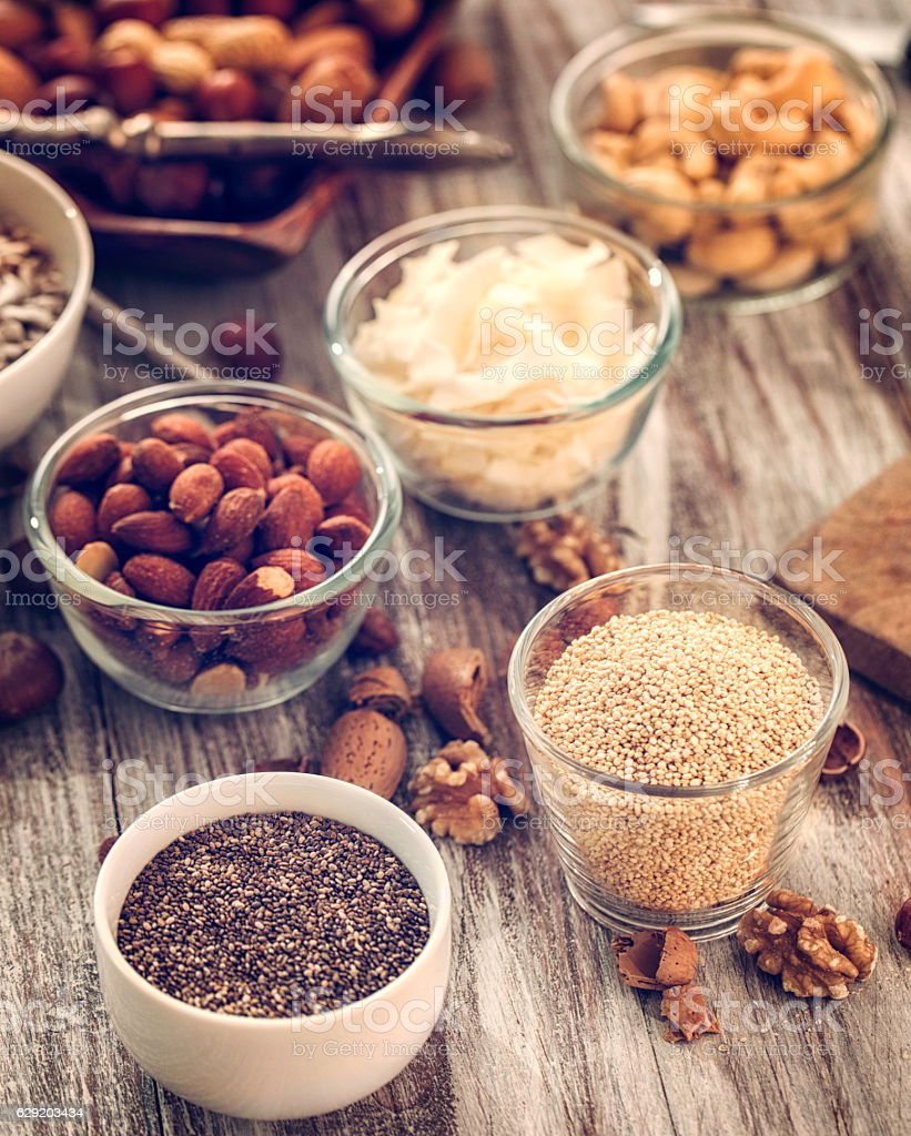 Superfoods in Bowls on Wooden Background stock photo