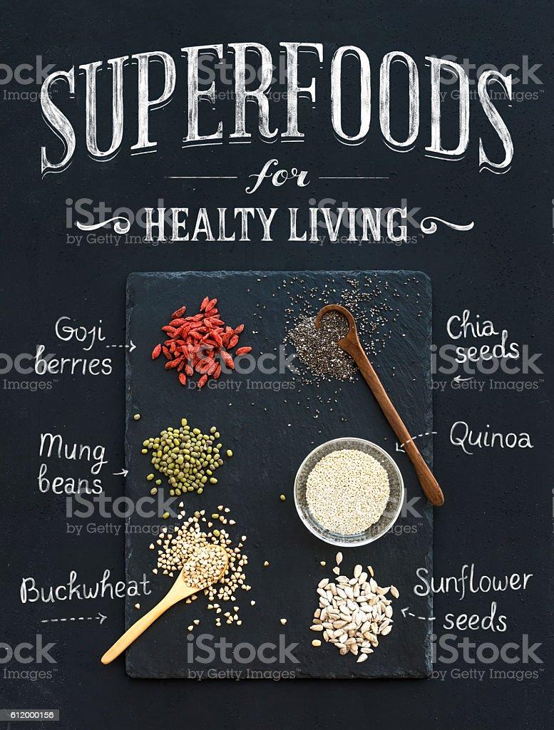 Superfoods on black chalkboard background stock photo