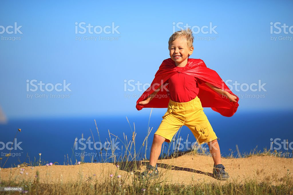 superhero boy on the shore stock photo