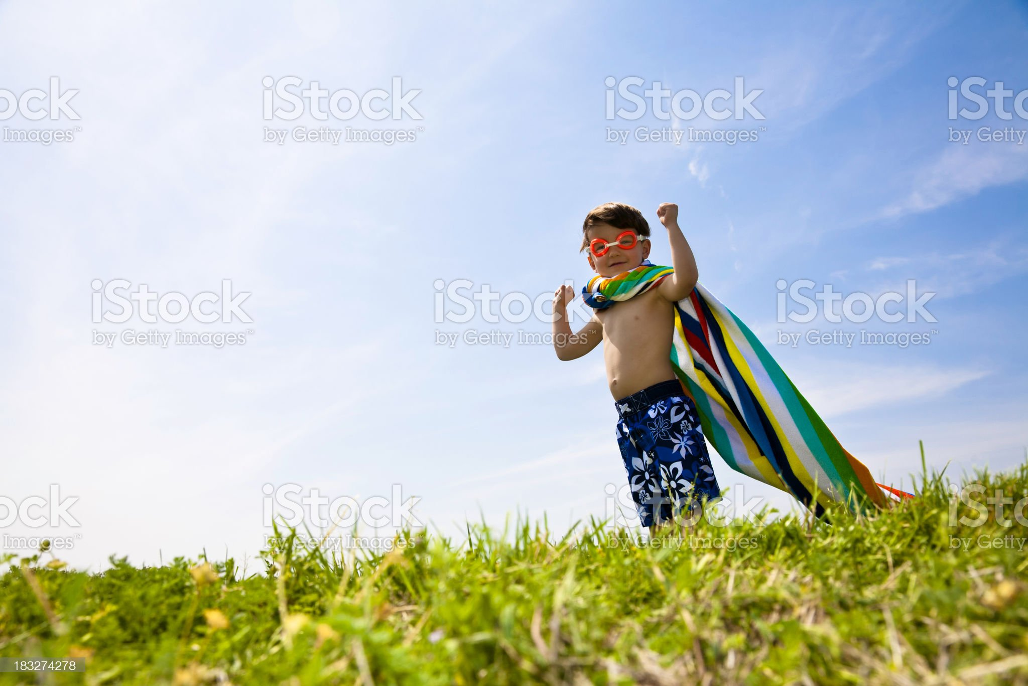 Superhero Boy With Arms Up Wearing Towel and Goggles royalty-free stock photo